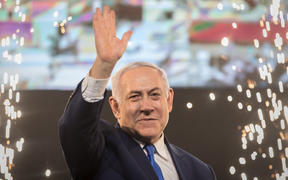 10 April 2019, Israel, Tel Aviv: Benjamin Netanyahu, Prime Minister of Israel, beckons supporters after the polling stations have been closed. Several hours after the closure of the polling stations in Israel, only partial results were available on the night of Wednesday.