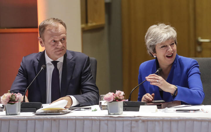European Council President Donald Tusk (L) and Britain's Prime Minister Theresa May look on during a European Council meeting on Brexit at The Europa Building at The European Parliament in Brussels on April 10, 2019.