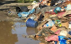Rubbish piled up after floods in a settlement in Nadi, Fiji