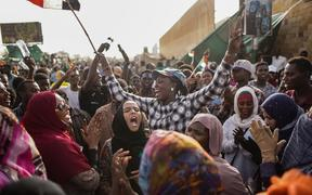 11 April 2019, Sudan, Khartoum: Sudanese demonstrators celebrate the arrest of long-time President Omar al-Bashir by the armed forces,