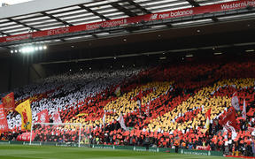 "Liverpool's fans hold up a mosaic making out the number ""96"" as they observe a minute's silence for the 30th Anniversary of the the Hillsborough disaster."