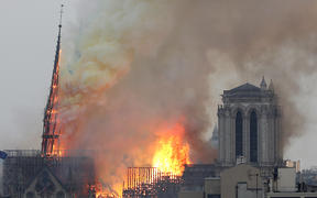 Flames engulf a spire of the medieval  Notre-Dame Cathedral.