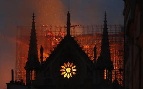 Flames and smoke rise from Notre-Dame de Paris Cathedral.