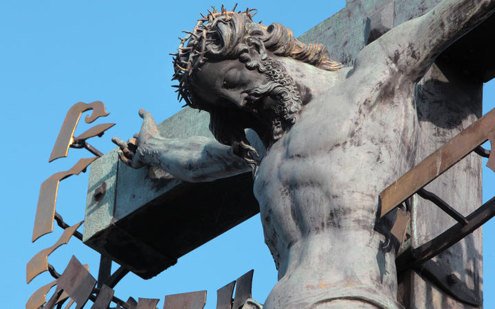 Detail of the Crucifix and Calvary sculpture, installed 1657, on the Charles Bridge or Karluv most over the Vltava river, Prague, Czech Republic. Bought in Dresden, this crucifix was originally made in 1629 by H Hillger after a design by W E Brohn.