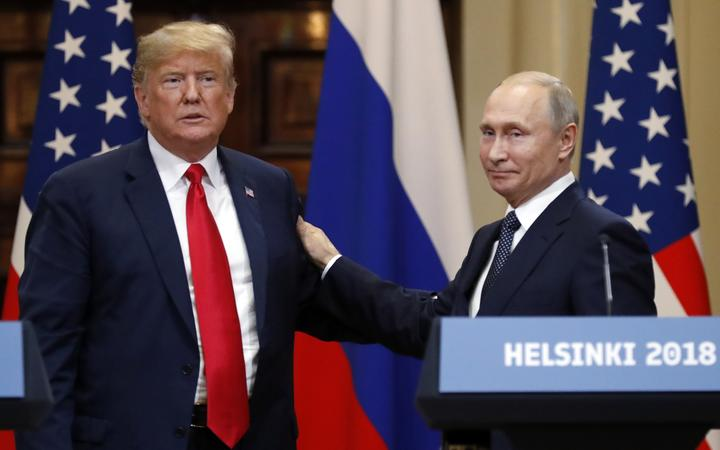 President of Russia Vladimir Putin and President of the US Donald Trump, left, during the joint news conference following their meeting in Helsinki.