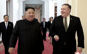 North Korean leader Kim Jong Un, center left, and US Secretary of State Mike Pompeo walk together before their meeting in Pyongyang, North Korea.