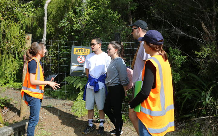 Auckland council offiers talk to trampers in the Waitakere Ranges.