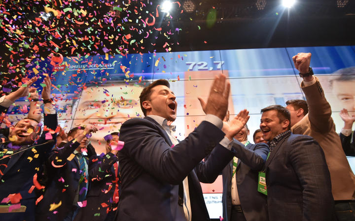 Ukrainian comedian and presidential candidate Volodymyr Zelensky reacts after the announcement of the first exit poll results in the second round of Ukraine's presidential election at his campaign headquarters in Kiev on April 21, 2019. (Photo by Genya SAVILOV / AFP)