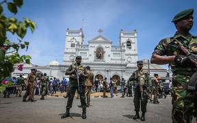 Sri Lankan military officers stand guard in front of the St Anthony's Church where an explosion took place in Kochchikade, Colombo, Sri Lanka, on Easter Sunday, April 21, 2019.