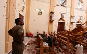 Officials inspect the damaged St. Sebastian's Church after multiple explosions targeting churches and hotels across Sri Lanka on Easter Sunday, April 21, 2019 in Negombo, north of Colombo, Sri Lanka.