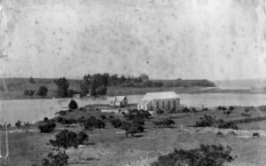 A photograph of the marae at Te Tii, on the banks of the Waitangi River in 1880.