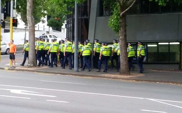 Police on the way to Sky City ahead of the TPP signing.