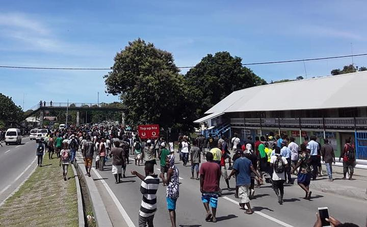 One of the angry mobs in Solomon Islands walking down the main road past Chinatown in Honiara after the election of the prime minister. 24 April 2019