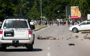 Rocks on the road following the rioting in Honiara.