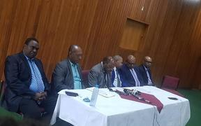 The five members of Papua New Guinea's government who have resigned.