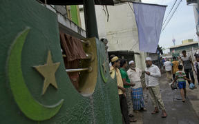 Muslim men gather outside a mosque in Colombo, Sri Lanka, on Friday 26 April.