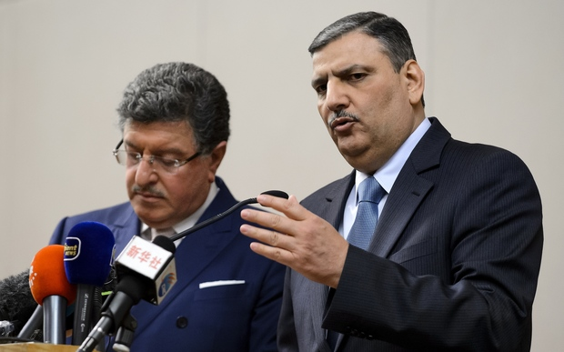 Syrian opposition chief Riad Hijab (R) gestures next to High Negotiations Committee (HNC) spokesman Salem al-Meslet during a press conference after Syrian peace talks on 3 February 2016 in Geneva.
