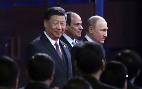 From left, Chinese President Xi Jinping, Egypt's President Abdel-Fattah El-Sisi and Russian President Vladimir Putin arrive for the opening ceremony of the second Belt and Road Forum for International Cooperation (BRF) in Beijing,