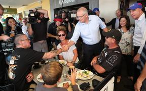 Australia's Prime Minister Scott Morrison greets supporters at an election launch rally in Brisbane.