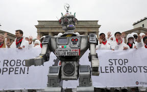 Protesters make their views known on killer robots in front of Berlin's Brandenburg gate, March 21 2019.