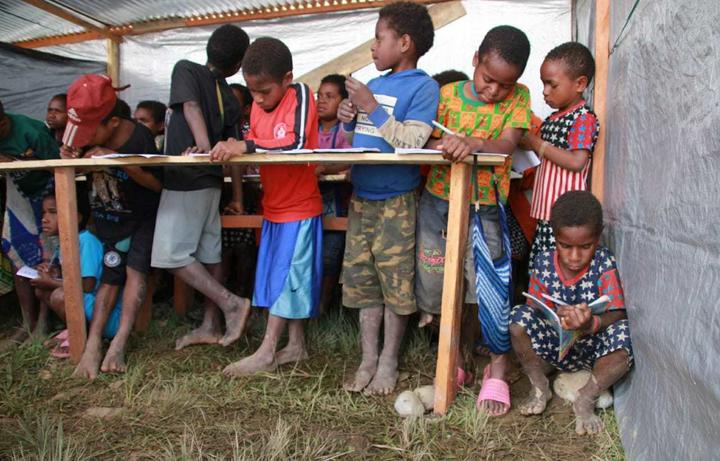 Emergency temporary school for displaced Papuan children in Wamena.