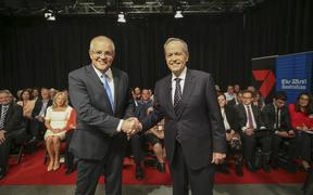 Australia's Prime Minister Scott Morrison (L) and opposition leader Bill Shorten shake hands before the first televised leaders debate in Perth.