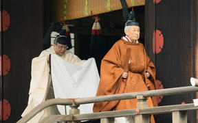 Japan's Emperor Akihito, right, leaves after a ritual to report his abdication to the throne, at the Imperial Palace in Tokyo on 30 April, 2019.