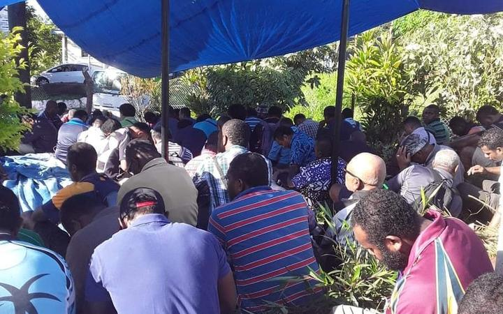 Water Authority of Fiji workers wait outside the company's Kinoya station in the capital this morning.