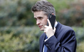File photo of Britain's Defence Secretary Gavin Williamson speaking on a mobile phone as he arrives at 10 Downing Street. He's been sacked over the leak of details of a plan to use Huawei to build the UK's 5G network.