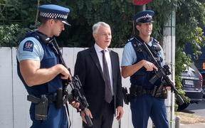Phil Goff with armed police officers at Otahuhu.