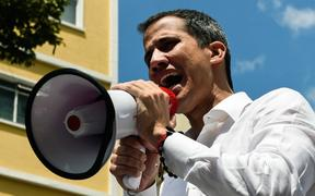 Venezuelan opposition leader and self-proclaimed acting president Juan Guaido speaks during a demo in Caracas on March 9, 2019.