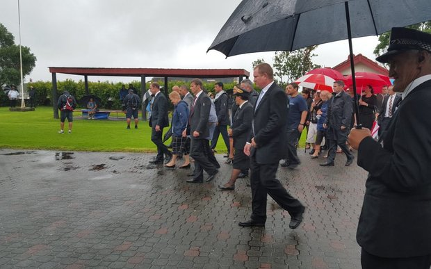 Labour leader Andrew Little leads the delegation onto the marae at Waitangi.