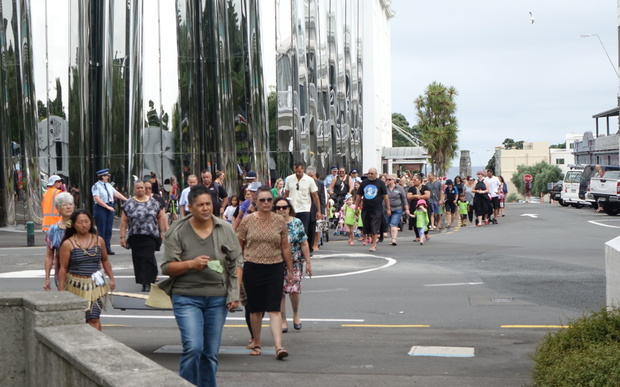 The Walk For Peace passes in front of the Len Lye Centre on its way to the courthouse in New Plymouth.