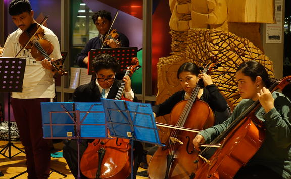Some of the Virtuoso Strings members performing at the opening of a photo exhibition on the orchestra.