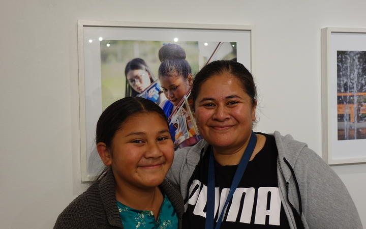 Nina Nimarota (R) and her daughter. Her daughter's photo is part of the Virtuoso Strings photo exhibition at Pataka in Porirua.