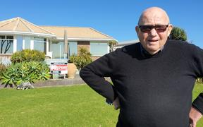 George Corlett outside his Onaero home.