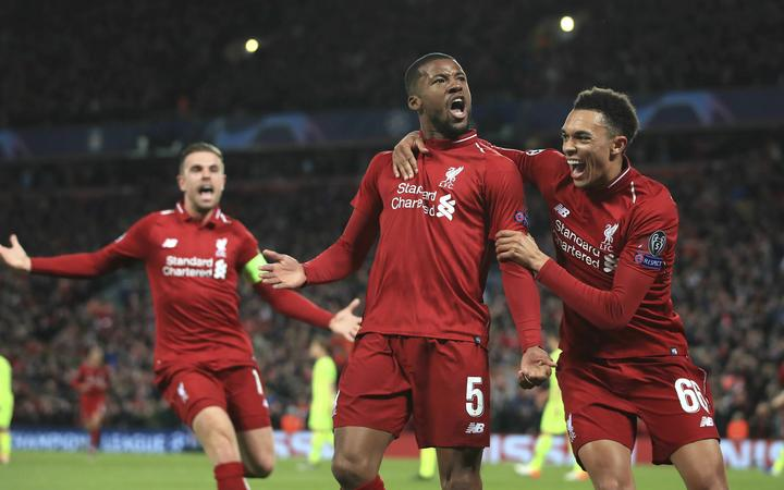 Liverpool's Georginio Wijnaldum, center, celebrates scoring his side's third goal during the Champions League semi final between Liverpool and Barcelona at Anfield.