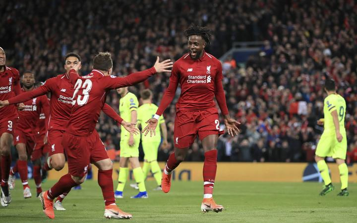 Liverpool's Divock Origi, center, celebrates scoring his side's fourth goal during the Champions League Semi Final between Liverpool and Barcelona at Anfield