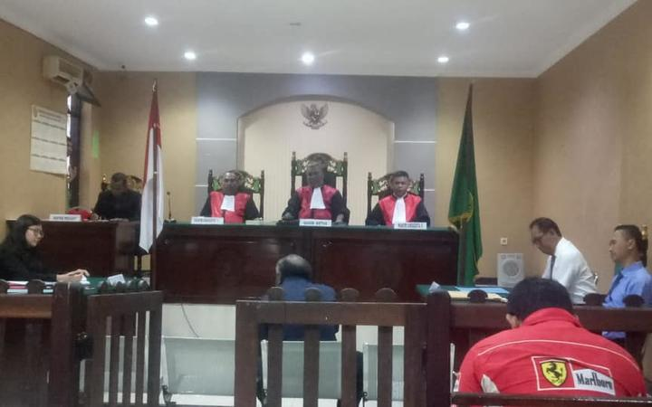 The trial of Yakonias Womsiwor and Erichzon Mandobar in Timika district court.