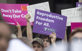 Protestors rally outside the Georgia State Capitol following the signing of legislation banning abortions once a foetal heartbeat.