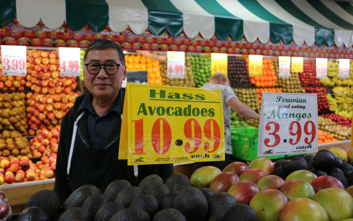 Avocados for sale at $10.99 each in Jack Lum's Auckland greengrocery.