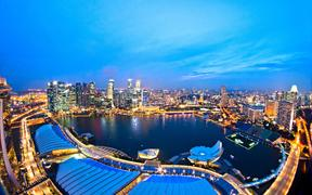 19628987 - fish-eye view of singapore city skyline at sunset.