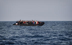 A rubber boat with migrants is seen off the Libya coast (file image).