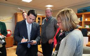 The Porteous and Keene families were in Wellington today meeting with National MPs to gather more signatures for a petition on random roadside drug testing. Simon Bridges (L).
