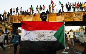 Sudanese demonstrators demand a civilian transition government in front of military headquarters this month.