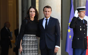 "Prime Minister Jacinda Ardern is welcomed by French President Emmanuel Macron at the Elysee Palace for the launch the global ""Christchurch Call"" initiative to tackle the spread of extremism online, on 15 May."