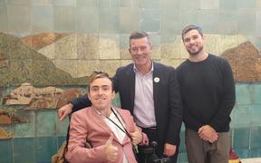 Joshua Perry, National list MP Michael Woodhouse and Mr Perry's carer Tim Marshall.