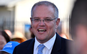 Australia's Prime Minister Scott Morrison talks to the media outside a polling booth during Australia's general election in Sydney on May 18, 2019.