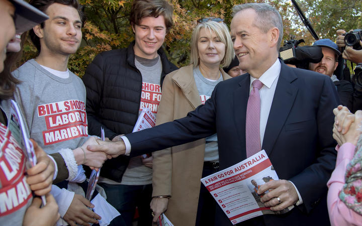 Australian Labor Party leader Bill Shorten, right, shakes hands with supporters at a polling station for a federal election in Melbourne, Australia, Saturday, May 18, 2019.