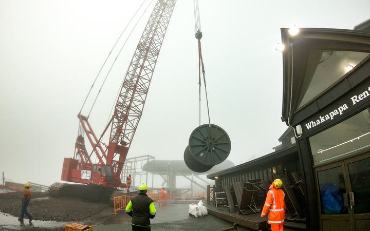 A 48,000kg spool for the gondola rope being lifted into place.